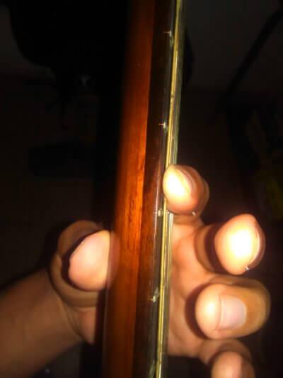 posicion correcta de la cejilla en guitarra